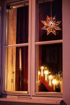 Christmas Candles In Windows