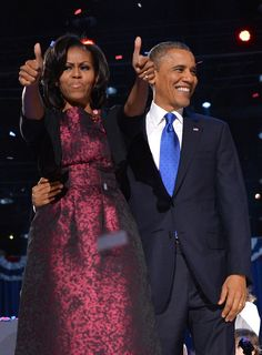 US President Barack Obama smiles as First Lady Michelle Obama gives the thumbs-up following Obama's speech on election night November 6, 2012 in Chicago, Illinois.