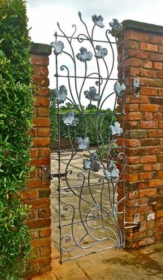 This gate is one of three opening onto a courtyard in a private garded in Mobberley, Cheshire. The finish is acid etched galvanized steel which is rust resistant and gives a leaden, antique finish