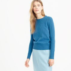 Meet Holly, a classic J.Crew silhouette that we resurrected from the archives and updated with bright new colors. It's the perfect gift for everyone on your list —yourself included. <ul><li>Semifitted.</li><li>Hits at hip.</li><li>Lambswool.</li><li>Rib trim at neck, cuffs and hem.</li><li>Dry clean.</li><li>Import.</li></ul>