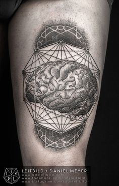 Awesome collage of geometric shapes and brain tattoo on thigh by daniel meyer