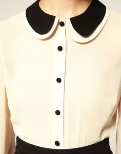I love the peter pan style collar and also the contrast with the black and cream.