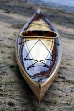 One sleek wood strip kayak by heirloomkayak.com