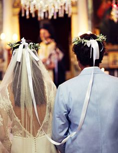 Wedding in Mitzela, Greece :  At the altar in stefana, linked crowns that are a staple of Greek Orthodox weddings.