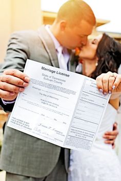 Wedding day photo with the marriage license