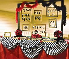 Back drop of hanging frames with Stars and Black and white photos in them for behind the dessert table... oohh lala Also like the material!