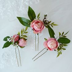 A trio of exquisite pink roses and buds, with honeysuckle, twigs, and foliage. The largest pin of the three is just 3 in size. My flowers are made of the highest quality materials, and will last a lifetime (or more) if handled with loving care. – COLORS: pink, white, greens – ATTACHES: