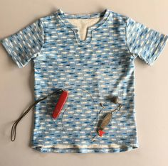 NEW H & G's Keyhole T-shirt, with an easy neck opening, a yoke pocket and a scooped hemline. Great for your Hunter and Gatherer to keep warm, collect treasures and look uber cool. Sewing Patterns For Kids, Keep Warm, Uber, Hemline, Men Casual, Pocket, Cool Stuff, Easy, Mens Tops