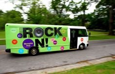 The Memphis Hop Tour bus rolls through Overton Park on its route among 11 Memphis art and entertainment destinations. The bus makes hourly stops at destinations including Graceland, Stax, the Memphis Zoo, Memphis Brooks Museum of Art, Pink Palace Museum and the National Civil Rights Museum. (Mike Brown)