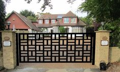 CONTEMPORARY DRIVEWAY WROUGHT IRON GATE