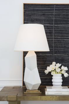KELLY WEARSTLER   BAYLISS TABLE LAMP. Ceramic fractured lamp available in black or white