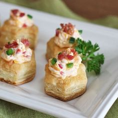 Puff pastry cups filled with pimento cheese and sprinkled with bacon pieces.