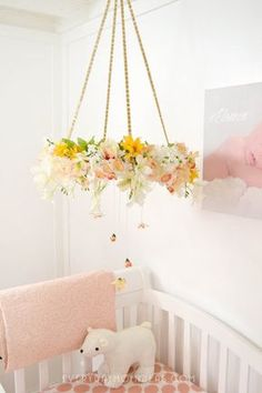 DIY easy floral baby mobil for under $20.00 and One hour. Get full step by step tutorial and supply list at Everyday Mom Ideas
