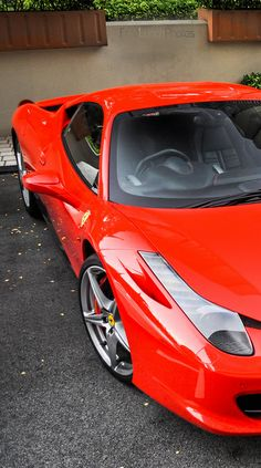 it's a crime to call this color red. That's way beyond red. Ferrari 458
