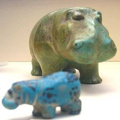 Two ancient Egyptian pottery hippos, photographed by nikoretro in the British Museum in London.