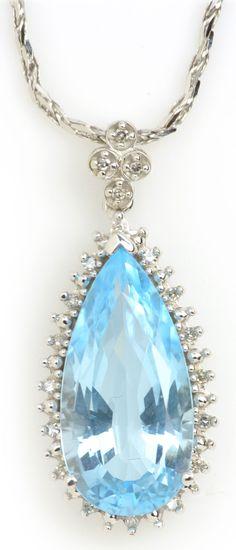 Blue Topaz Pendant Necklace in White Gold. Item #347-111016 Estate 7.00 ct Blue Topaz Pear & 0.10 ctw Diamond Round 14K White Gold Pendant Approx.Wt. Length