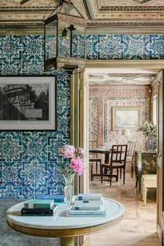 Blue-and-white Portuguese tiles from the century cover the walls of the entry hall. Art by Giovanni Battista Piranesi; antique iron lantern - A Bavarian Jewel Box Retreat Designed by Studio Peregalli Wood Staircase, Teak Table, Aging Wood, Portuguese Tiles, Wood Ceilings, Entry Hall, Home Living, Living Room, Living Spaces