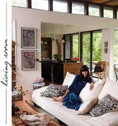 DESIGN DECODED living room Design Decoded ikat cushions, silk ones, cream sofa grey rug and natural wood coffee table
