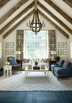 I love the exposed wood beams, the white and curtains.
