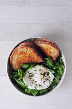 grilled cheddar & goat cheese sandwich, with a fried egg & arugula salad