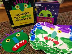 "Squeeze a small amount of each color on one side of a piece of cardstock, ""squash"" it closed, ""smoosh"" it around and open it back up to make monsters! Add the eyes, nose, mouth and teeth with construction paper after they dry."