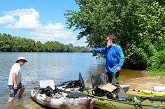 Kayak fishermen at the Dixon Landing take out at James River State Park, Virginia