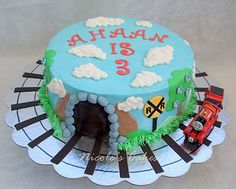 Given Joshua's obsession with trains right now, I have a feeling we will be doing a train theme b-day party.  he would love this one