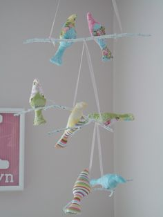 Baby bird mobile - not such cute colors though.... @Hilary MacDonald