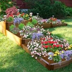 raised flower beds -- these pre-built ones are pretty but expensive to buy and can be built easily and more affordable.