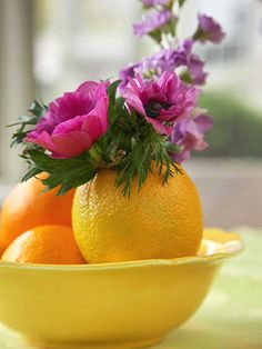 Set an orange or lemon on a flat surface to see which end will make a stable base. If necessary, cut off some of the bottom to make it flat. Cut a hole in the top and scoop out the insides with a grapefruit spoon. Cut a piece of wet florist's foam to fit inside; then push stems into the foam.