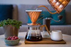 """Hario V60 equipment. The server in olive wood, the copper dripper and the """"Buono"""" copper drip kettle. Liquorice by Johan Bülow"""