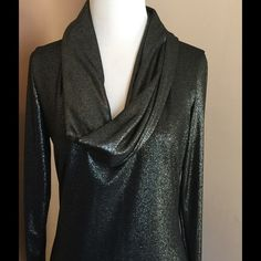 Gorgeous Sparkling Black Top !   Gorgeous long sleeved ! Cowl neckline ! Black that sparkles with silver ! 93% polyester 7% spandex ! Wash delicate cold, dry flat. Easy ! About 32 inches in length !  My mannequin is size 2 - 4 and it fit fine ! Made in USA  Suzanne Somers Tops