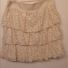 Off white lacy skirt Cute off white lacy skirt. Never worn. Maurices Skirts Midi