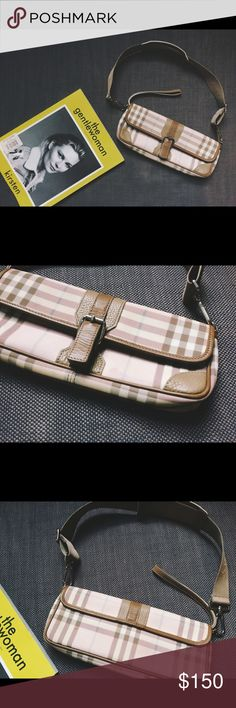 """Original Burberry Pink Nova Check Clutch In good used condition. The leather has some stains here and there from the use and that's why the price is so low. Other than that it still has a lot of life. Message me if you need more pictures. Measurements: 10.5"""" L x 4"""" H x 1.5 D The strap drop is adjustable and its 11"""" max. f you like it make me an offer! Burberry Bags Clutches & Wristlets"""