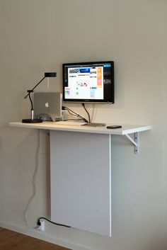 really clever way to hide wires and such... I think I'll build off this idea, pinning everything to the underside of my desktop