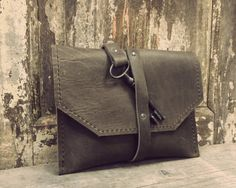 A beautiful handmade leather cluth from Anne Meiborg.