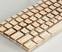 Strangely modded Apple keyboard with sandblasted lumber keys
