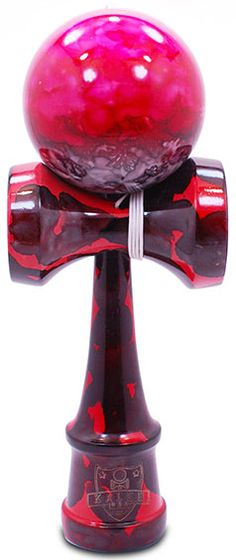Red Sea Marble Kendama - Unique fully marble painted with pink, red & black swirled together to make this stylized Red Sea themed Kendama.  Kaleb Kendama brings the simple yet extremely fun Japanese ball and cup toy to you. Made of solid wood and will come exactly as pictured. EXTRA replacement string included with every Kendama.