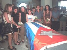 Relatives and friends of Cuban dissident Jesus Yanes Pelletier gather around his flag draped coffin September 19, 2000 in Havana, Cuba. Pelletier died of a heart attack at age 83 September 18. Formerly an aid to Cuban President Fidel Castro, Pelletier later turned against the Communist regime. He was famous for refusing orders to poison Castro when the revolutionary youth was in jail in th mid 1950's.