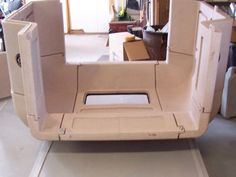 Several different panel types like corners and windows assemble together to create the full camper