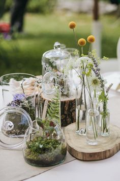 Try adding many jars full of succulents and wildflowers as your centerpieces at your wedding.