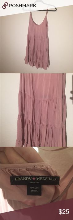 Brandy Melville ( LIKE NEW) Pink Jada Dress Brandy Melville (LIKE NEW) Jada Pink/ Champagne Dress Size: one size Color: Dark Pink/ Champagne (lighter than in the pictures) Description: - Adjustable straps - Backless except for the string in the middle - Ruffled layers - Very flowly and airy (not tight) - No damages or stains  Send me an offer :) Same day shipping! Brandy Melville Dresses Midi