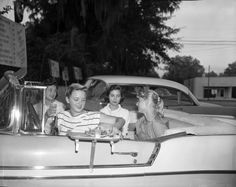 Teens at a local drive-in restaurant. Tallahassee, FL (1957) © Don Richards