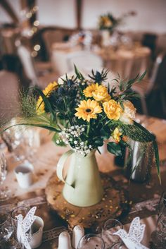 Jug Centrepiece Log Decor Hessian Tables Outdoorsy Rustic Sunflowers Wedding http://www.helenjanesmiddy.com/