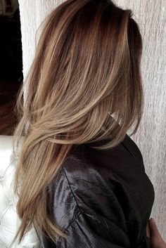 Long brown hair with blonde balayage chic sophistication length side swept