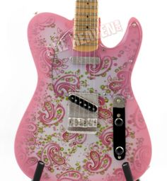 a pink paisley guitar?! absolutely!
