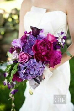 {Cascading Bouquet In Pink & Purple Hues... Magenta Peonies, Purple Orchids, Purple Sweet Pea, Purple Callas, Lavender Roses, Pink Roses, & Greenery}