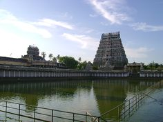 Chidambaram - North Gopuram and tank    Normally big temples in tamil nadu have gopurams paving way to the temple in all four directions. Also they have a tank.This is a snap of the north gopuram and tank of the Chidambaram temple