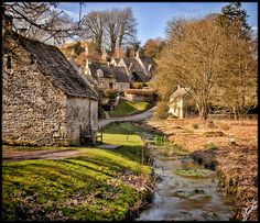 Arlington Row in the Cotswold village of Bibury, Gloucestershire, South West England, UK