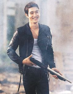 Choi Si Won... Too funny! Check out the grin on his face while carrying a shotgun in a smoky scene!